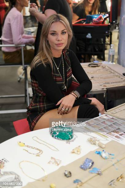 Guest prepares backstage before the Christophe Guillarme show as part of the Paris Fashion Week Womenswear Spring/Summer 2019 on October 2, 2018 in...