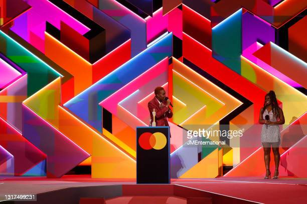 Guest Presenter Clara Amfo on stage while Arlo Parks wins the Breakthrough Artist award during The BRIT Awards 2021 at The O2 Arena on May 11, 2021...