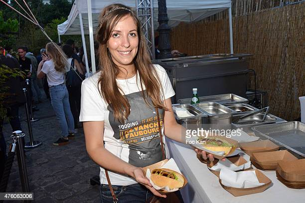 A guest presents the kielbasa saussage of Chef Isaac McHale during the Fooding 15th Anniversary Party Day One at La Rotonde Stalingrad on June 5 2015...