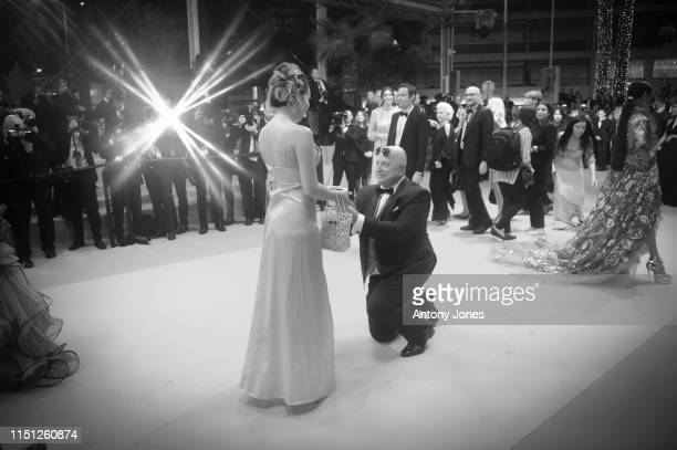 A guest proposes to his companion on the red carpet as they arrive for the screening of Mektoub My Love Intermezzo during the 72nd annual Cannes Film...