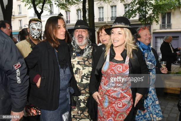 Guest, Rachid Taha and jewellery designer Olivia Zeltner attend Zelia Van Den Bulke Aprons show At Zelia Abbesses Shop on May 1, 2018 in Paris,...