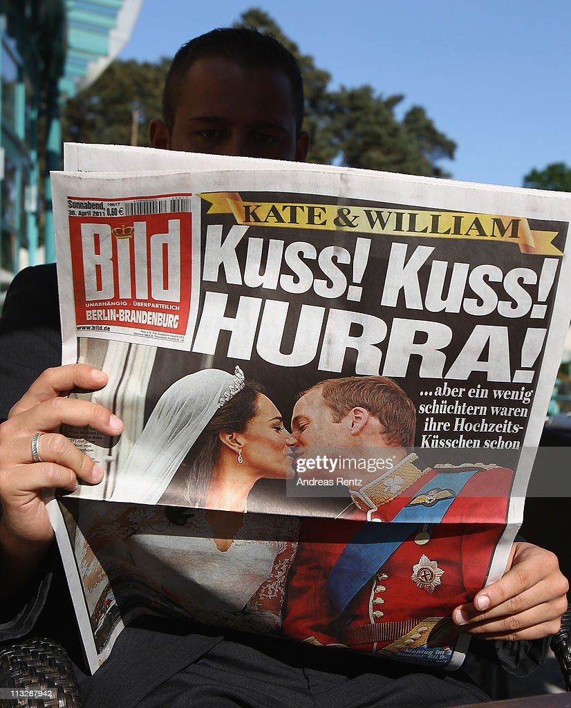 A guest reads a German newspaper that shows on front page a picture of the the Royal Highnesses Prince William, Duke of Cambridge kissing Catherine, Duchess of Cambridge on April 30, 2011 in Bad Saarow, Germany. The marriage of the second in line to the British throne was led by the Archbishop of Canterbury and was attended by 1900 guests, including foreign Royal family members and heads of state April 29.