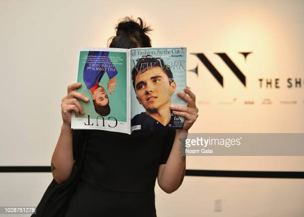 A guest reads a magazine from the Wynn newstand seen around New York Fashion Week The Shows at Spring Studios on September 7 2018 in New York City