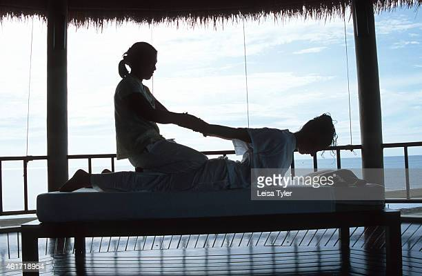 A guest receives a Thai massage at boutique resort Aleenta's spa pavilion An ancient health therapy originating from India and the breathing exercise...
