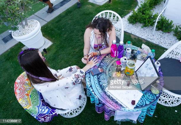 Guest receives henna tattoo at beGlammed Sunset Soiree Presented by Fullscreen on April 12 2019 in Palm Springs California