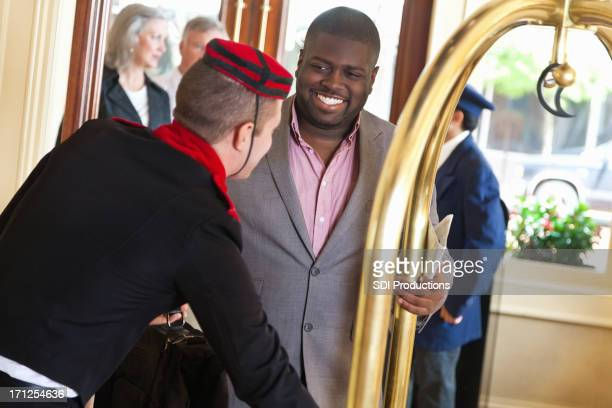 Guest receiving help from hotel bellhop