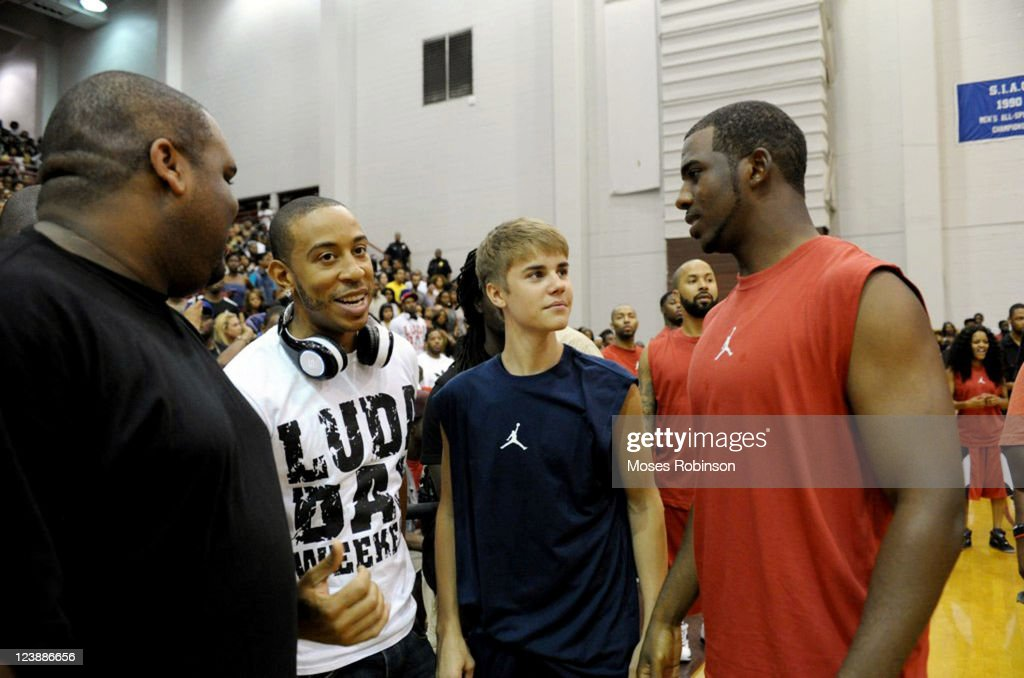 Guest, recording artist Ludacris, recording artist Justin Bieber and NBA Player Chris Paul attend the 2011 LudaDay Weekend on September 4, 2011 in Atlanta, Georgia.