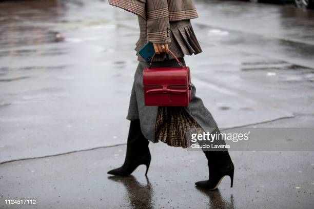 A guest red bag details is seen outside Elie Saab show during Paris Fashion Week Haute Couture Spring Summer 2019 on January 23 2019 in Paris France