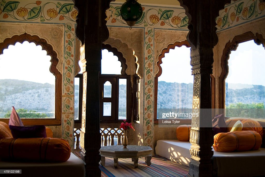 A guest room at Castle Bijaipur. Armed with his marble-white palace built in the 16th century, Rao Saheb Narendra Singh was one of Rajasthan's first Thakors to open his family home to tourists. Although slightly faded around the edges, it's impossible to beat the hotel's location - rising above a cobble-street village and surrounded by the Uindhyachal mountain range, which is a short drive from the bustling city of Chittorgarh and further afield, Udaipur. Sixteen rooms - some furnished with antique pieces, open-air lounge areas with low slung fans and a slate blue swimming pool are tucked amongst the turrets and courtyards of the three-storey palace, which comes alive to the sounds of local musicians at cocktail hour. Most visitors come here on a tour - to trek into the surrounding hills on the castle's stable of fine-boned Marwari horses, or for the intrepid, week-long safaris through nearby wildlife sanctuaries and tribal lands, sleeping in tents along the way. Others come for the daily yoga classes taken by Narendra Singh himself, who fell in love with India's ancient art of breath through movement after a visiting yogi showed him a few asanas. Since then, the reining Thakor's gentle but effective yoga retreats have become a highlight; Kate Moss recently checked in for a whole month.