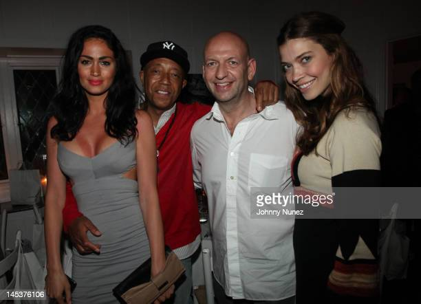Guest Russell Simmons David Rosenberg and Tina Marie Clark attend the 3rd Annual Angel Wings Foundation Dinner at Georgica on May 27 2012 in...