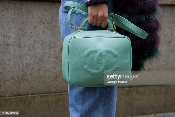 Guest seen at Skylight at Moynihan Station outside the Jeremy Scott show with mint green leather Chanel purse during New York Fashion Week Women's...
