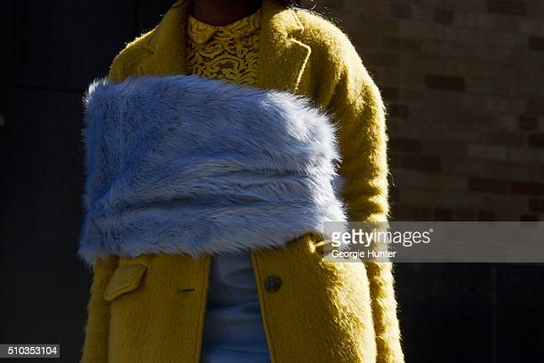 Guest seen at Skylight Clarkson Sq outside the Derek Lam show wearing yellow coat and blue fur shawl during New York Fashion Week Women's Fall/Winter...