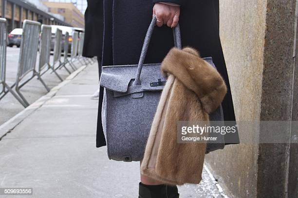 Guest seen at Skylight Clarkson Sq outside the Erin Fetherston show with grey bag and fur shawl during New York Fashion Week Women's Fall/Winter 2016...