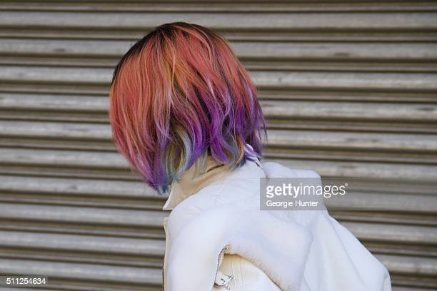 Guest seen at Skylight Clarkson Sq outside the Ralph Lauren show wearing white coat with white fur collar with pink purple and green dyed hair during...