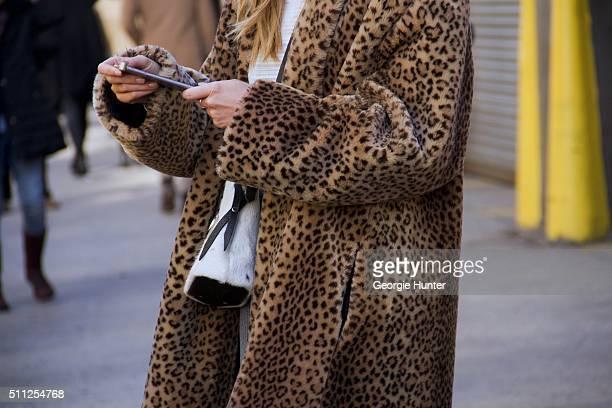 Guest seen at Skylight Clarkson Sq outside the Ralph Lauren show wearing leopard print faux fur coat during New York Fashion Week Women's Fall/Winter...