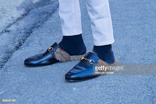 Guest seen at Skylight Clarkson Sq outside the Robert Geller show wearing black leather loafers with fur insoles during New York Fashion Week Men's...
