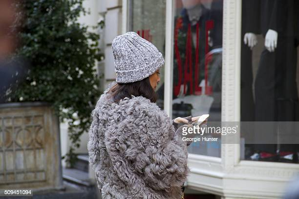 Guest seen at The Apartment by The Line outside the Protagonist presentation wearing oversized grey coat and grey knitted beanie hat during New York...