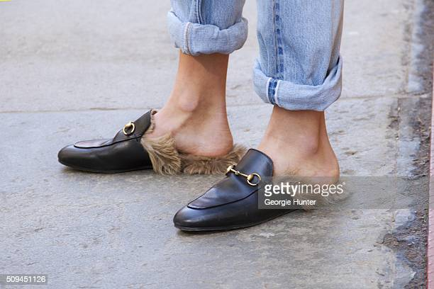 Guest seen at The Apartment by The Line outside the Protagonist presentation wearing black leather Gucci loafers with fur insoles during New York...