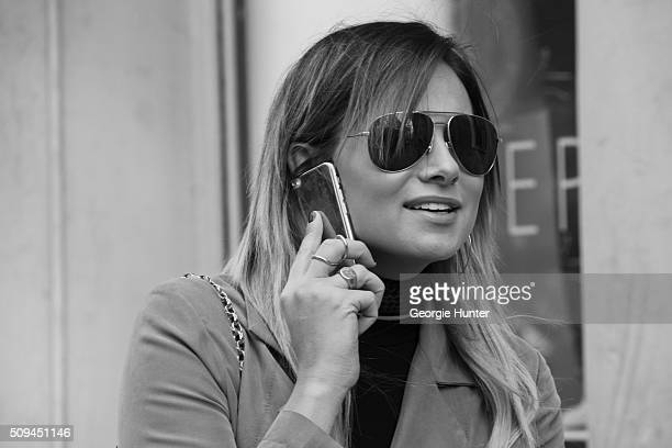 Guest seen at The Apartment by The Line outside the Protagonist presentation wearing brown trench coat and aviator sunglasses during New York Fashion...