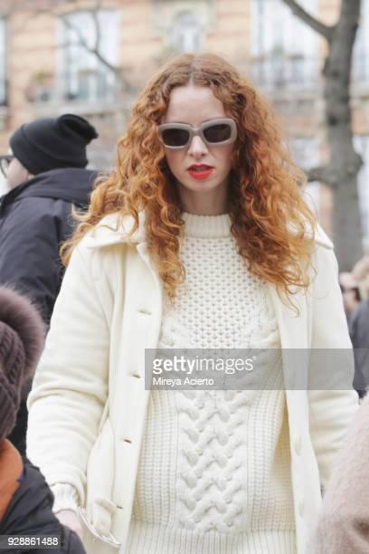 A guest seen at the Miu Miu fashion show during Paris Fashion Week Womenswear Fall/Winter 2018/2019 on March 6 2018 in Paris France