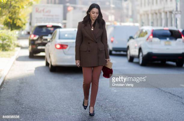 A guest seen in the streets of Manhattan outside Michael Kors during New York Fashion Week on September 13 2017 in New York City