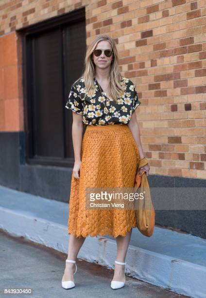 A guest seen wearing a blouse with floral print midi skirt in the streets of Manhattan outside Adam Selman during New York Fashion Week on September...