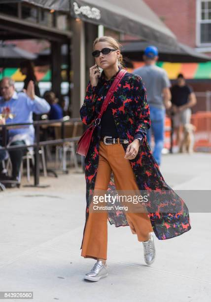 A guest seen wearing a kimono orange pants in the streets of Manhattan outside Creatures of Comfort during New York Fashion Week on September 7 2017...
