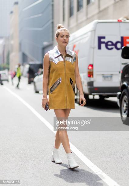 A guest seen wearing Margiela dress in the streets of Manhattan outside Desigual during New York Fashion Week on September 7 2017 in New York City