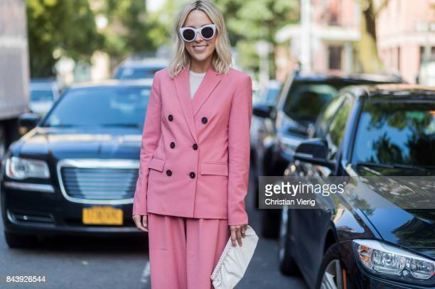 A guest seen wearing wearing a salmon coloured suit in the streets of Manhattan outside Creatures of Comfort during New York Fashion Week on...