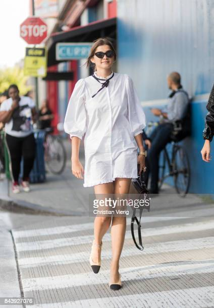 A guest seen wearing white dress Chanel slingbacks in the streets of Manhattan outside Ulla Johnson during New York Fashion Week on September 7 2017...