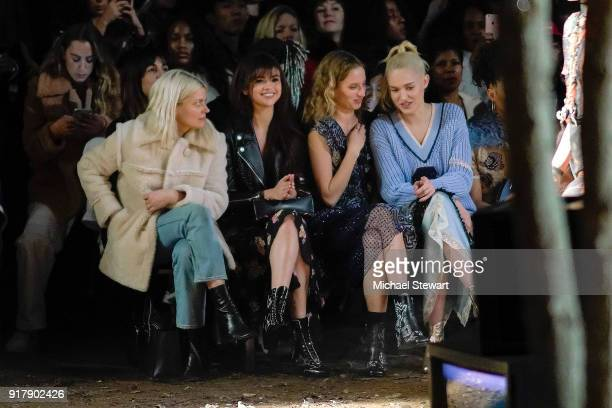 Guest Selena Gomez Petra Collins and Carlotta Kohl attend the Coach 1941 fashion show during New York Fashion Week on February 13 2018 in New York...