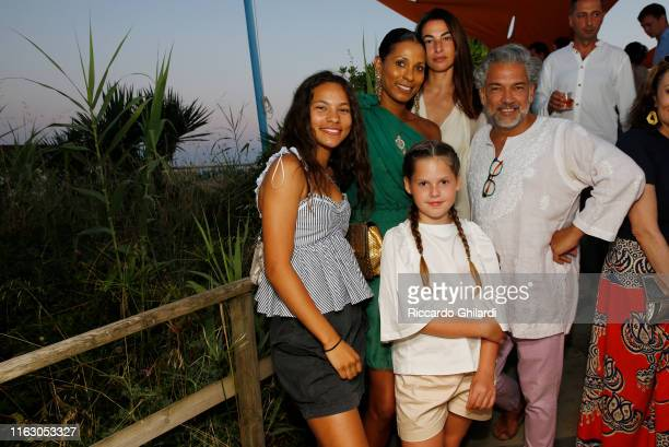 Guest Sherrett Dahlstrom Annalisa Bugliani with her daughter and Carlos Mota attend the welcome dinner celebrating the opening of Rachel Lee...