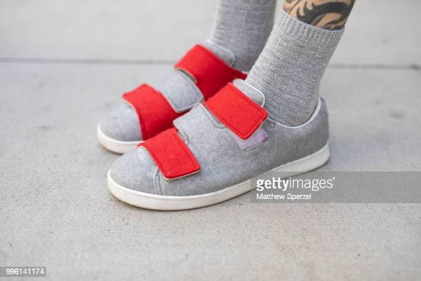 A guest shoe detail is seen on the street attending Men's New York Fashion Week wearing grey felt shoes on July 10 2018 in New York City