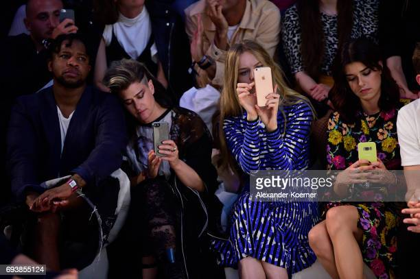 A guest Singer Peaches Actress Lilith Stangenberg and Model Marie Nasemann take a photo with their smartphone of designer Vivienne Westwood during a...