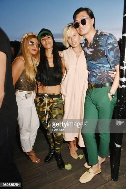 A guest Singer Shy'm model Iguana Butane and PR Axel Huyhn attend 'Ibiza Boheme' Launch Party By BHV Marais on BHV Marais Boat on June 7 2018 in...