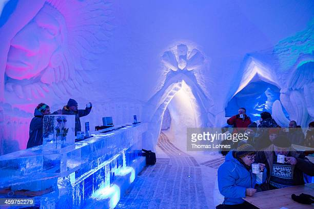 Guest sit in the bar of the 'IgluLodge' on December 29 2013 in Oberstdorf Germany The Igloo Hotel under the peak of the 'Nebelhorn' at about 1900...