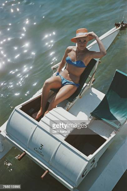 A guest sits in a pedalo at the Carlton Hotel Cannes France July 1958