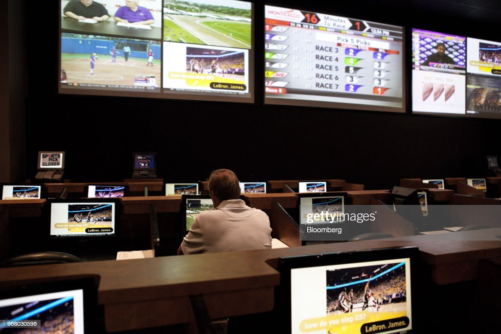 A guest sits in the sportsbook area of during the launch of full-scale sports betting at Dover Downs Hotel and Casino in Dover, Delaware, U.S., on Tuesday, June 5, 2018. Delawarebecame the first U.S. state aside from Nevada to allow wagers on individual professional sporting contests, just three weeks after the U.S. Supreme Court freed states to do so. Photographer: Michelle Gustafson/Bloomberg via Getty Images
