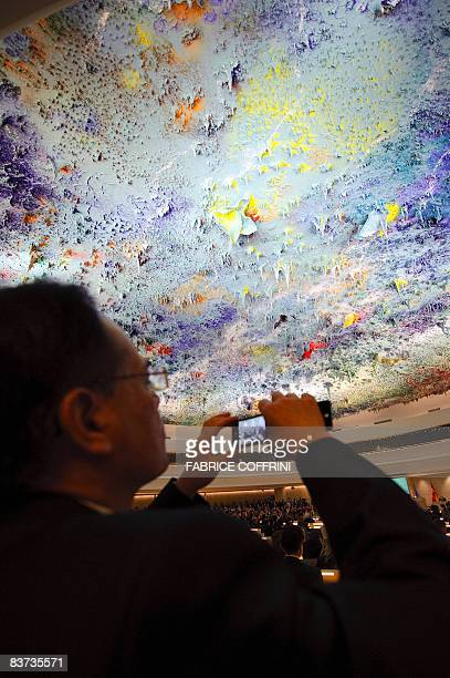 A guest snaps a picture during the inauguration of the Room XX on November 18 2008 at the United Nations offices in Geneva Top contemporary Spanish...