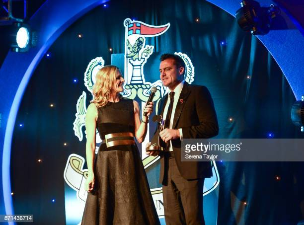 Guest Speaker Gabby Logan speaks with Ex Player Steve Harper as he accepts an award for Les Ferdinand as he is inducted into the hall of fame during...