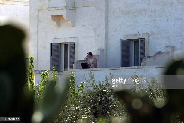 A guest stands on a balcony of the Bagno Egnazia resort in Fasano in the southern Italian region of Puglia where actors Justin Timberlake and fiance...