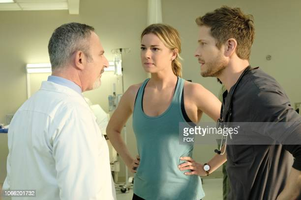 Guest star Andy Milder Emily VanCamp and Matt Czuchry in the 'Trial Error' episode of THE RESIDENT airing Monday Nov 5 on FOX