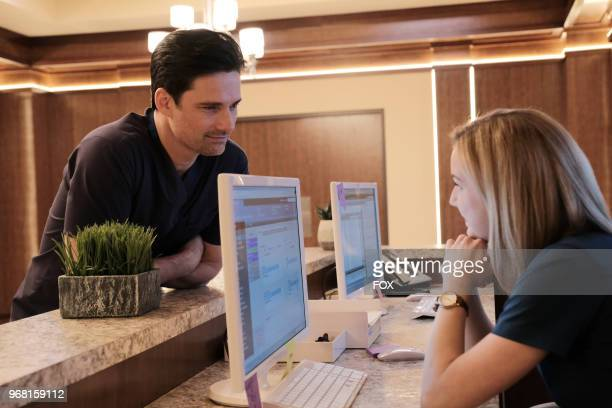 Guest star Warren Christie and Emily VanCamp in the 'Haunted' episode of THE RESIDENT airing Monday April 16 on FOX