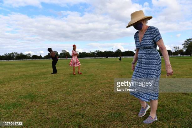 Guest stomps down divots in between polo matches at Grandiosity Events 4th annual Polo & Jazz celebrity charity benefit hosted by Real Housewives of...