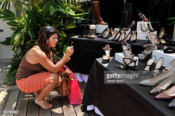 A guest takes a picture of Via Spiga footwear's Winter/Holiday line at Alison Brod Public Relations Los Angeles Summer Style Event on June 15 2011 in...