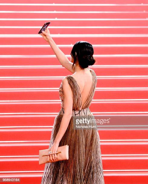 A guest takes a selfie at the screening of Under The Silver Lake during the 71st annual Cannes Film Festival at Palais des Festivals on May 15 2018...