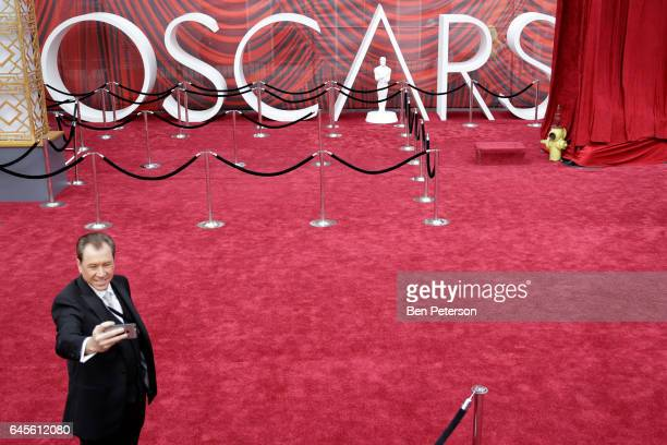 A guest takes a selfie on the red carpet at the 89th Annual Academy Awards at Hollywood Highland Center on February 26 2017 in Hollywood California