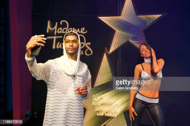 A guest takes a selfie with a figure of RB Princess Aaliyah during an unveiling at Madame Tussauds Las Vegas at The Venetian Las Vegas on August 21...