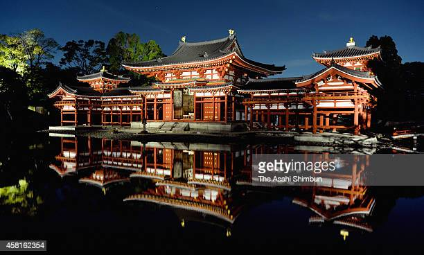 Guest takes photographs of illuminated Byodoin temple's Phoenix Hall on October 30, 2014 in Uji, Kyoto, Japan. The Phoenix Hall, the most famous...