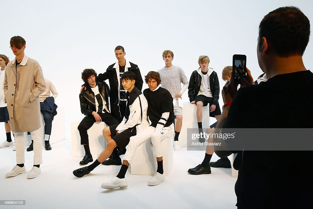 A guest takes photos on an iphone at the Plac Presentation during New York Fashion Week: Men's S/S 2016 at Industria Superstudio on July 13, 2015 in New York City.
